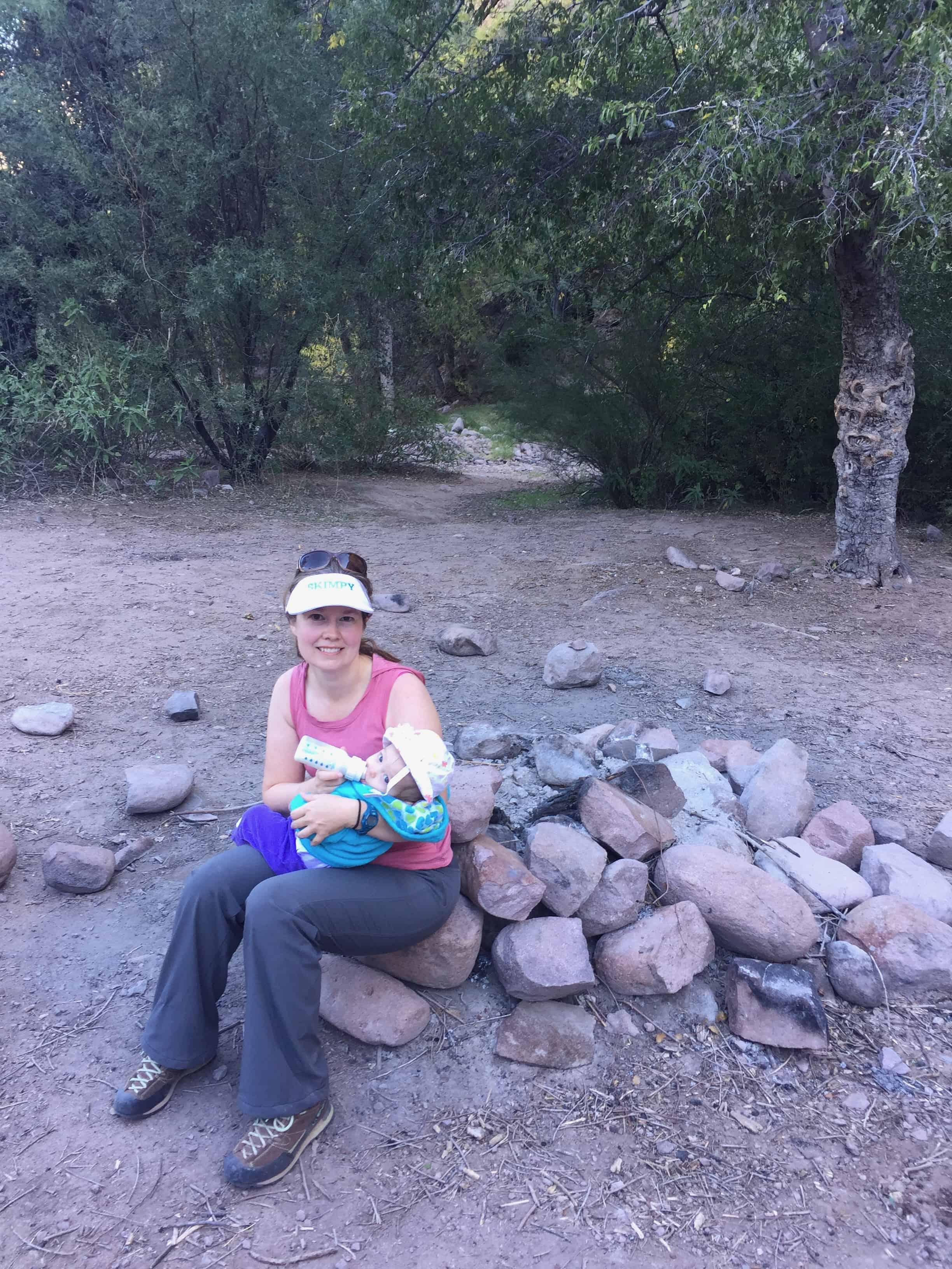 Taking a break from hiking to feed a baby on First Water Trail in the Superstition Mountains.